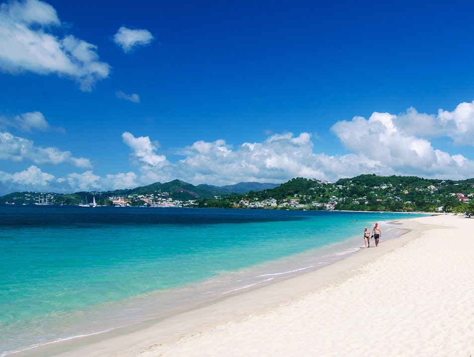 The longest of Grenada's 45 beaches, 2-mile long Grand Anse Beach with the view of capital city of St. George's