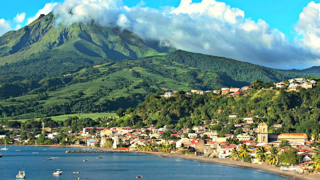 Vulcanic Mont Pelée dominates the island on the edge of Caribbean and Atlantic waters.
