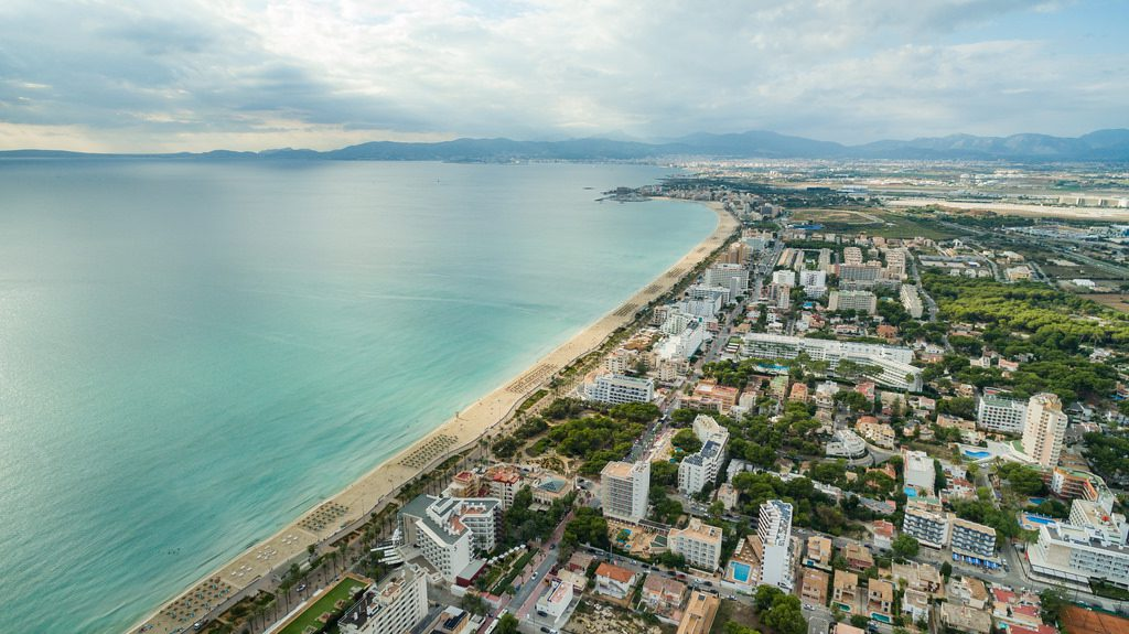 Coastal line of Palma de Mallorca fully explores the potential of the island: sandy beaches, impressive mountains and world renown night-life.