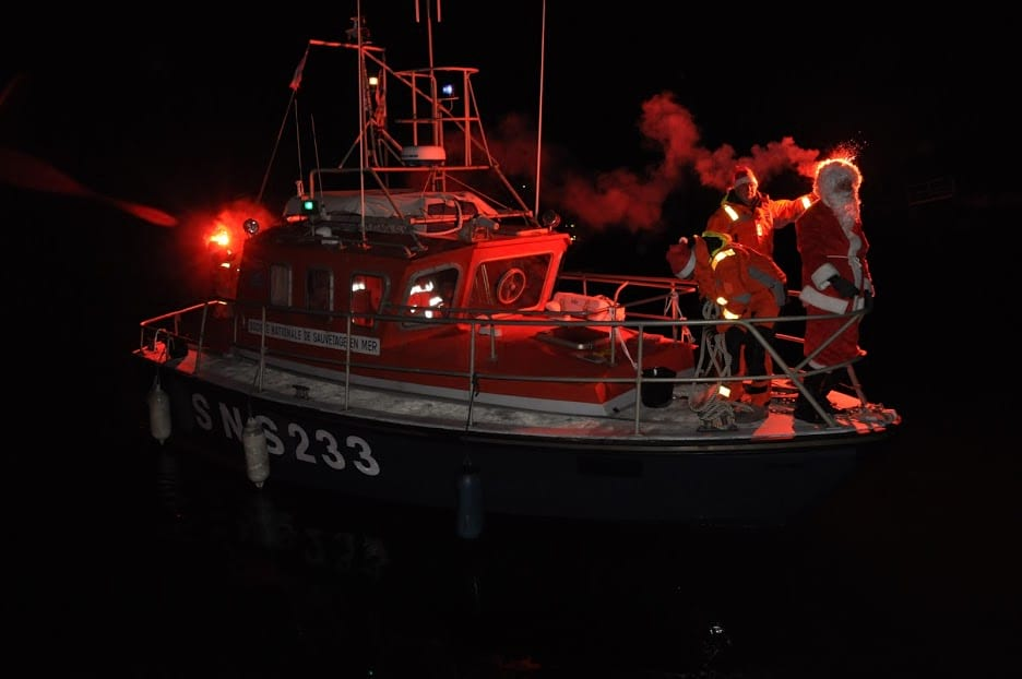 Not even darkness of night can stop the good work done by St. Nicholas. When he doesn't ride a reindeer sleight, he skippers a boat.